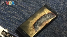 The burned Samsung Note 7 smartphone belonging to Brian Green is pictured in this undated handout photo obtained by Reuters, Oct. 6, 2016.