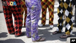 Who wears the pants in your family? These people wearing colorful pants may think they do. But maybe not. (AP PHOTO)