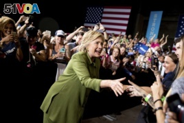 Democratic presidential candidate Hillary Clinton arrives to speak at a rally in Entertainment Hall at the Florida State Fairgrounds in Tampa, July 22, 2016.