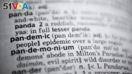 In this Saturday, Nov. 21, 2020, photo the word pandemic is displayed in a dictionary in Washington. Merriam-Webster on Monday announced