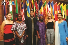 FILE - Berea College international students stand in front of the flags representing the 70 countries where they are from. (Handout photo from Berea)