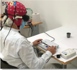 In this photo, a blind patient is seen taking part in experiments carried out by American and European researchers in the field of optogenetics. During the experiments, a 58-year-old blind man was able to use special eyeglasses to identify and count diffe