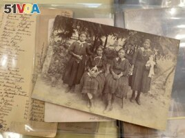 This July 8, 2021 image of material archived at the Center for Southwest Research at the University of New Mexico in Albuquerque, New Mexico, shows a group of unidentified Indigenous students who attended the Ramona Industrial School in Santa Fe. (AP Pho