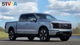 A pre-production Ford F-150 Lightning is shown in Bruce Township, Mich., May 12, 2021. (AP Photo/Paul Sancya)