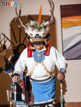 This May 26, 2018 photo provided by the Museum of Northern Arizona shows a performance of a deer dance at the Zuni Festival of Arts and Culture in Flagstaff, Ariz. (Ryan Williams/Museum of Northern Arizona via AP)