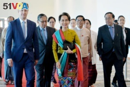 Myanmar's State Counsellor Aung San Suu Kyi departs from Naypyidaw International Airport ahead of her appearance at the International Court of Justice to defend the country against charges of genocide of its Rohingya Muslim minority, in Naypyidaw, Myanmar