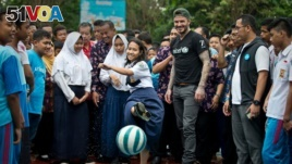 UNICEF Goodwill Ambassador David Beckham plays football with students and teachers at the SMPN 17 school in Semarang, Indonesia, March 27, 2018.