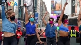 ILE PHOTO: Performers take part in a pop up Broadway performance in anticipation of Broadway reopening in Times Square amid the coronavirus disease (COVID-19) pandemic in the Manhattan borough of New York City, New York, U.S., March 12, 2021
