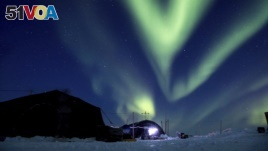 FILE - In this March 9, 2018, file photo provided by the U.S. Navy, the aurora borealis displays above Ice Camp Skate in the Beaufort Sea during Ice Exercise (ICEX) 2018.