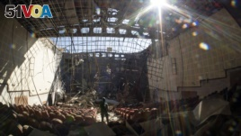 A view of the cultural center, destroyed by shelling during a military conflict, in Shushi, outside Stepanakert, the separatist region of Nagorno-Karabakh, Tuesday, Oct. 13, 2020. (AP Photo)