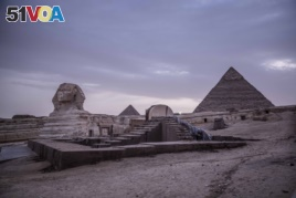 This March 30, 2020 photo, shows the empty Giza Pyramids and Sphinx complex on lockdown due to the coronavirus outbreak in Egypt.