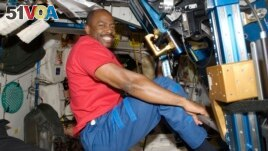 In this Nov. 22, 2009 photo made available by NASA, astronaut Leland Melvin, STS-129 mission specialist, exercises in the Unity module of the International Space Station. (NASA via AP)