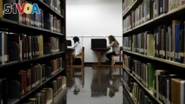 In this Friday, Oct. 19, 2012 file photo, students study in a library on the campus of California State University, Long Beach in Long Beach, Calif. (AP Photo/Jae C. Hong, File)