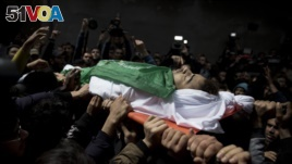 Palestinians carry the body of Tamir Abu al-Khair, 17, who was shot and killed on Saturday by Israeli troops during a protest next to the Israeli border, eastern Gaza Strip, out of the family home during his funeral in Gaza City, Sunday, March 31, 2019.