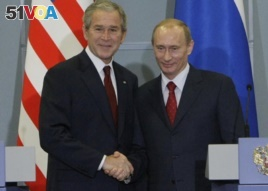 FILE - US President George W. Bush, left, with Russian President Vladimir Putin, right, at the end of their joint and final news conference, Sunday, April 6, 2008 in Sochi, Russia. (AP Photo/Pablo Martinez Monsivais)