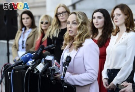 Actress Louisette Geiss addresses the media at a news conference by the
