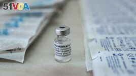 This photograph shows a vial of Pfizer/BioNTech vaccine against the Covid-19 (novel coronavirus) at the health center of Elafonissos, on the Elafonissos Island, on April 23, 2021.