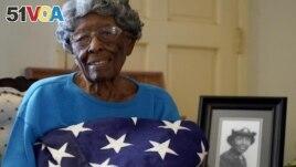 World War II veteran Maj. Fannie Griffin McClendon poses at her home, Thursday, June 10, 2021, in Tempe, Ariz. (AP Photo/Matt York)