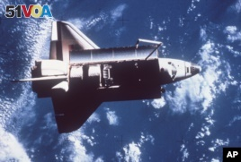 This photo is the first showing the complete space shuttle Challenger orbiting the earth. (1983 / AP Photo)
