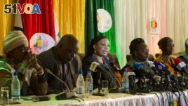 Zimbabwe Electoral Commission Chairwoman Qhubani Moyo, center, announces the results of the presidential election in Harare, Zimbabwe, Aug. 3, 2018.