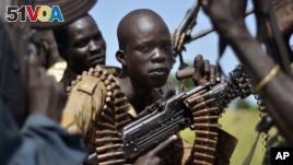 South Sudan government soldiers in the town of Koch, Unity state, South Sudan. A U.N. report describing sweeping crimes like children and the disabled being burned alive and fighters being allowed to rape women as payment shows South Sudan is facing