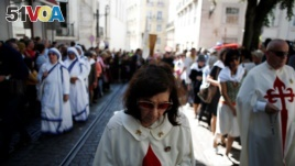 People take part in the St. Anthony procession in Lisbon, Portugal, June 13, 2018.