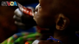 A mother feeds her child with a peanut-based paste for treatment of severe acute malnutrition in a UNICEF supported hospital in the capital Juba, South Sudan. (File)