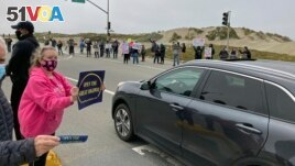 People rally to reopen the Great Highway to vehicles again in San Francisco, on May 1, 2021. (AP Photo/Janie Har)