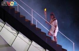 FILE - Tennis champion Naomi Osaka lights up Olympic cauldron July 23, 2021