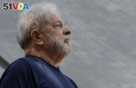 FILE - Former Brazilian President Luiz Inacio Lula da Silva looks on before speaking to supporters outside the Metal Workers Union headquarters in Sao Bernardo do Campo, Brazil, April 7, 2018.