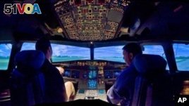 A U.S. Airways Airbus A320 simulator is shown at the airline's Charlotte training center in Charlotte, N.C., on Feb. 22, 2009. Based at the airport, the training center each year hosts about 20,000 US Airways employees, including a majority of the airline's pilots and flight attendants. Jeff Skiles, the first officer on Flight 1549, completed training on the Airbus A320 about a month before his plane was struck by birds, causing an engine failure that led to the water landing by Capt. Chesley