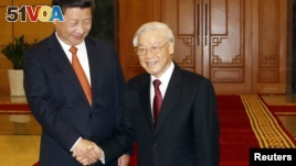 China's President Xi Jinping (L) and Vietnam's Communist Party General Secretary Nguyen Phu Trong shake hands at the Central Communist Party Office in Hanoi, Vietnam, 05 November 2015.