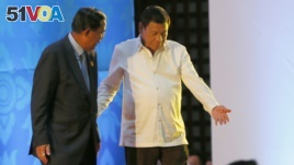 Philippine President Rodrigo Duterte, right, ushers Cambodian Prime Minister Hun Sen following the opening ceremony for the ongoing 28th and 29th ASEAN Summits and other related summits Tuesday, Sept. 6, 2016 in Vientiane, Laos. (AP Photo/Bullit Marquez)
