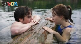 This image released by Apple TV+ shows Ferdia Walsh-Peelo, left, and Emilia Jones in a scene from