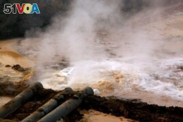 FILE PHOTO: Polluted water flows out of pipes from a rare earth factory near Baotou, a city in China's Inner Mongolia Autonomous Region in this picture from 2010. (Reuters)ure.