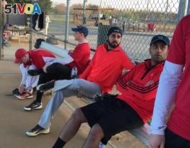 Danish Bashir sits in the dugout at a softball game in Springfield, Virginia. (C. Presutti/VOA)