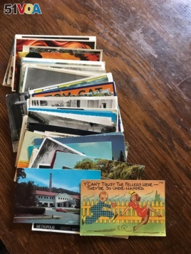 This stack of postcards Greg has sent to Eve. She calls it another