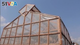The solar tent is made from clear plastic. The plastic is stretched over a large wooden structure. (Source: VOA)