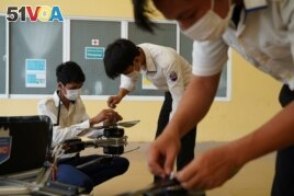 Students of the National Polytechnic Institute of Cambodia prepare their manned drone for flight, in Phnom Penh, Cambodia, September 17, 2021. (REUTERS/Cindy Liu)