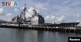 The USS Shiloh is docked at a port along Subic Bay, north of Manila, Philippines, May 30, 2015. USS Shiloh arrived in the country to replenish supplies and strengthen ties with the Philippines.