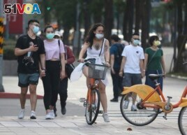 People wear face masks to protect against the spread of the coronavirus after the COVID-19 alert raise to level 3 in Taipei, Taiwan, Saturday, May 15, 2021.