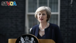 Britain's Prime Minister, Theresa May, has said Britain may begin the process of spliting with the E.U. next year..