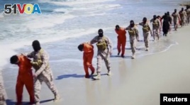 Islamic State militants lead what are said to be Ethiopian Christians along a beach in Wilayat Barqa, in this still image from an undated video made available on a social media website on April 19, 2015. (REUTERS/Social Media Website via Reuters TV)