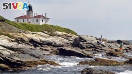 In this July 7, 2006, fishermen cast on the rocky shore at the Beavertail Lighthouse, the third-oldest lighthouse in America, at the tip of Beavertail State Park, on Narragansett Bay, in Jamestown, R.I.