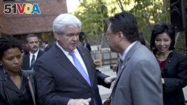 Former Republican presidential candidate Newt Gingrich meets with Asian-Americans during a 2012 campaign stop. Polls suggest Asian-American voters are impacting presidential elections.