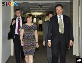 FILE - Acting Deputy U.S. Trade Representative Wendy Cutler (L) is greeted by her Japanese counterpart Hiroshi Oe (R) before their talks of the Trans-Pacific Partnership (TPP) free trade negotiations at the Foreign Ministry in Tokyo, July 9, 2015.