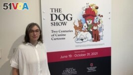 Anne Drozd, museum coordinator at Ohio State University's Billy Ireland Cartoon Library Museum, stands at the entrance to the library's new exhibit,