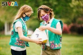 Here, Girl Scouts, Alice (left) and Gracie (right) look at a Wing delivery drone container, Christiansburg, Virginia, April 14, 2021. (Photo provided by Wing LLC.)