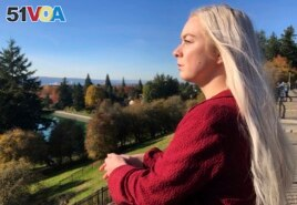 In this October 28, 2019, photo, Ashtyn Aure poses for a photo in Portland, Oregon. When Aure visited a clinic at Utah Valley University last year, she felt like she was having a breakdown.