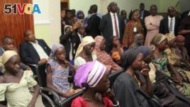 Nigerian vice president, Yemi Osinbajo and other officials meeting with the 21 Chibok girls released by Boko Haram militants October 13, 2016 at the DSS Hospital in Abuja.